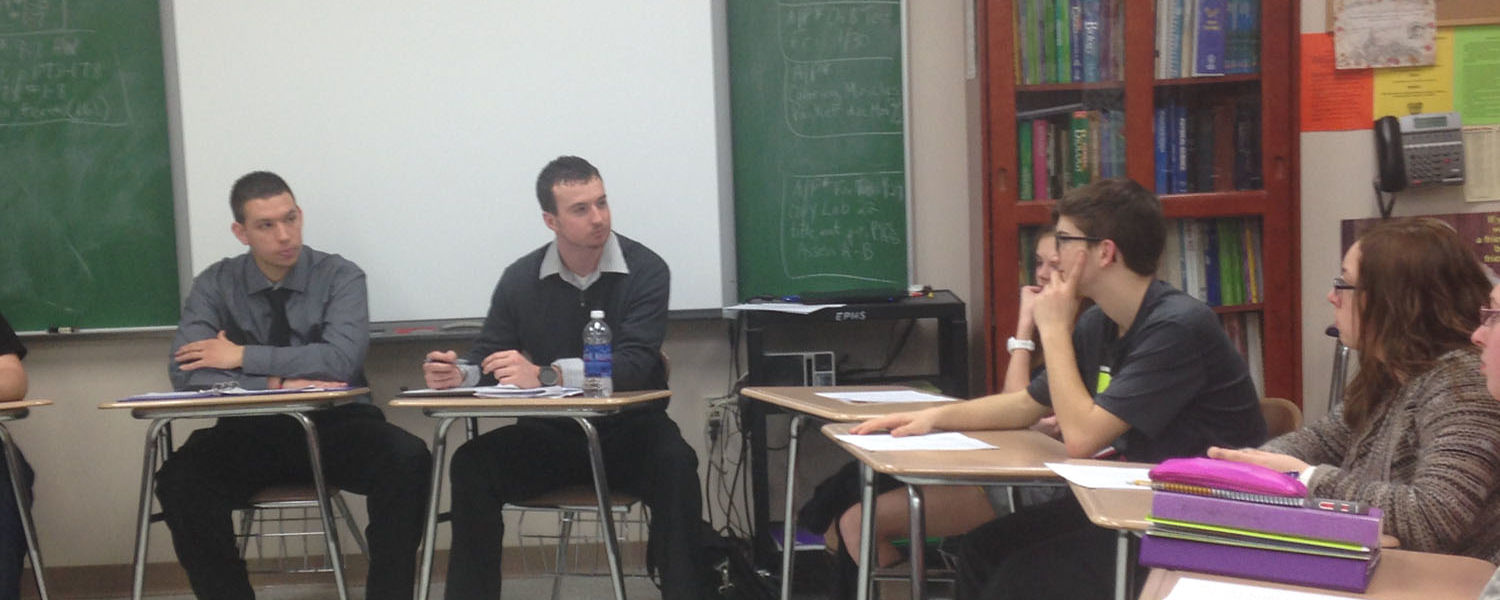 Kent State Salem students Austin Cope and Daniel Koehler recently facilitated a Justice Talking seminar for science club members at East Palestine High School.