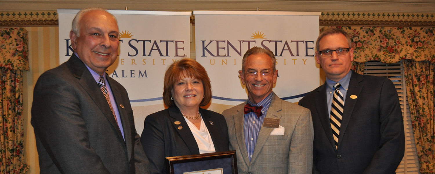 Accepting and presenting the Friends of the Campus Award were (from left) John Tonti, Consumers National Bank Board of Directors; Laurie McClellan, chairman of the board; Dr. Steve Nameth, dean of the Kent State Salem Campus; and Ralph Lober II, president