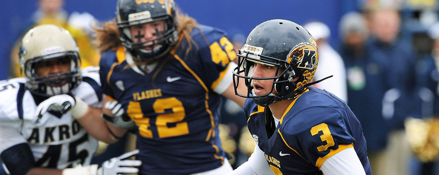 Kent State quarterback Spencer Keith runs the ball during a game against the University of Akron.