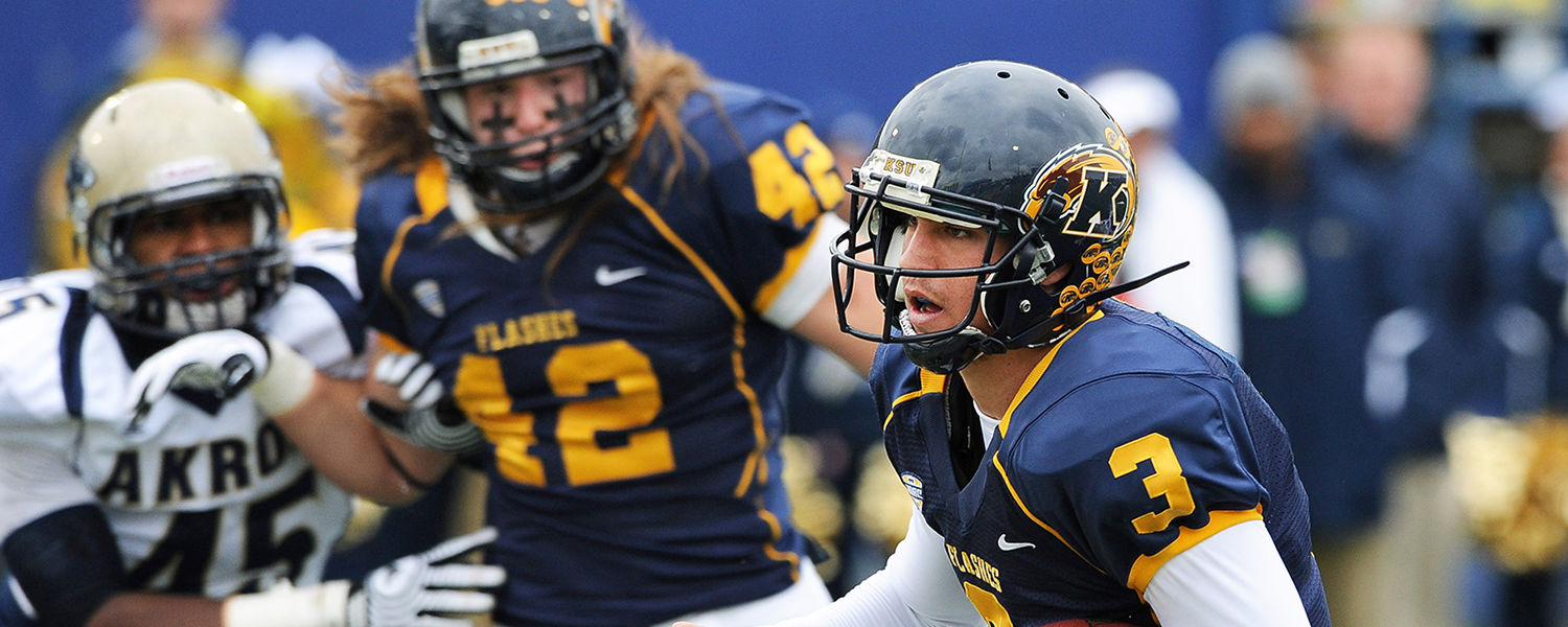Kent State quarterback Spencer Keith runs in for a 4-yard touchdown, during the Golden Flashes 35-24 victory over the University of Akron.