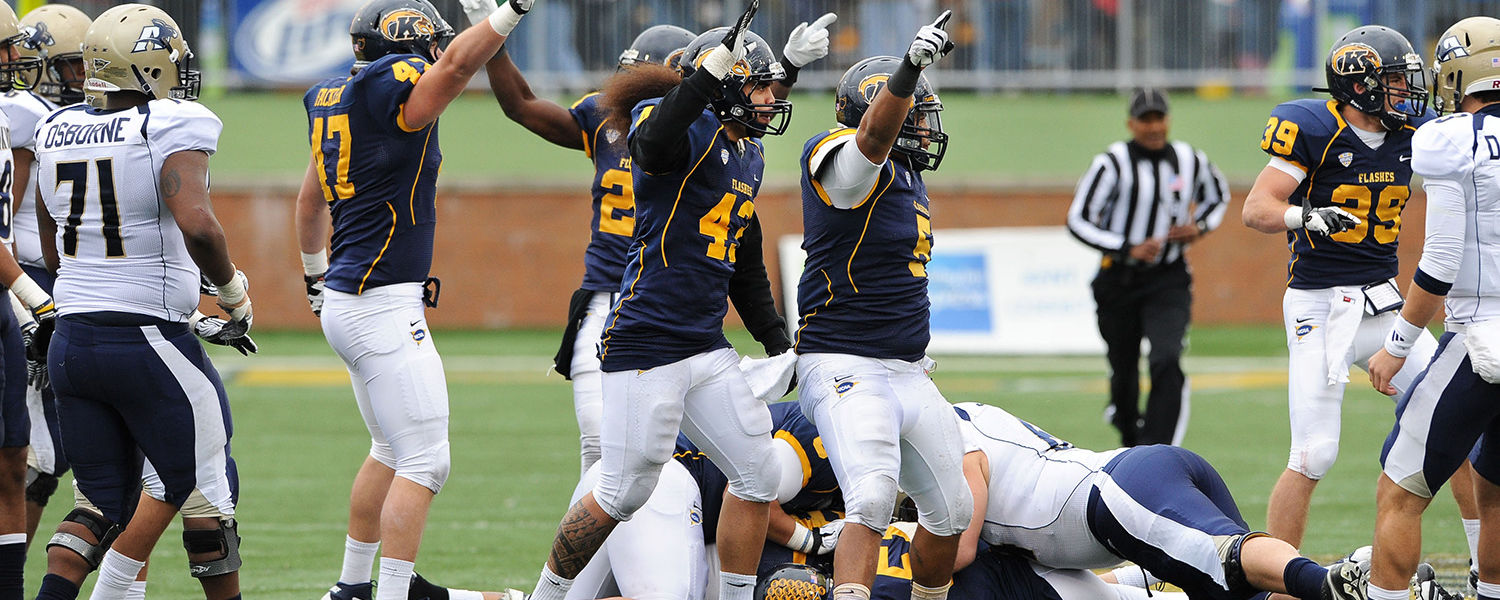 Kent State players celebrate a critical fumble recovery in the second half, against the University of Akron.
