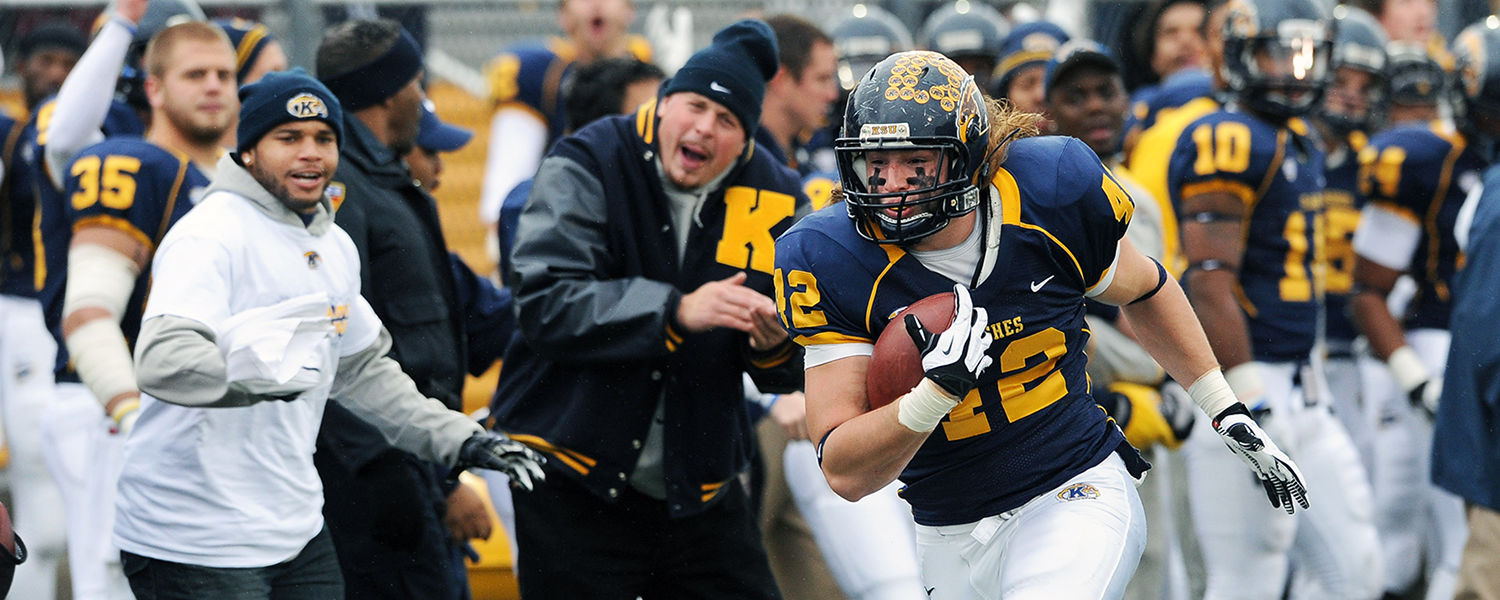 Kent State's Tim Erjavec rides the sideline after a catch, cheered on by teammates, during Kent State's 35-24 win over the University of Akron.