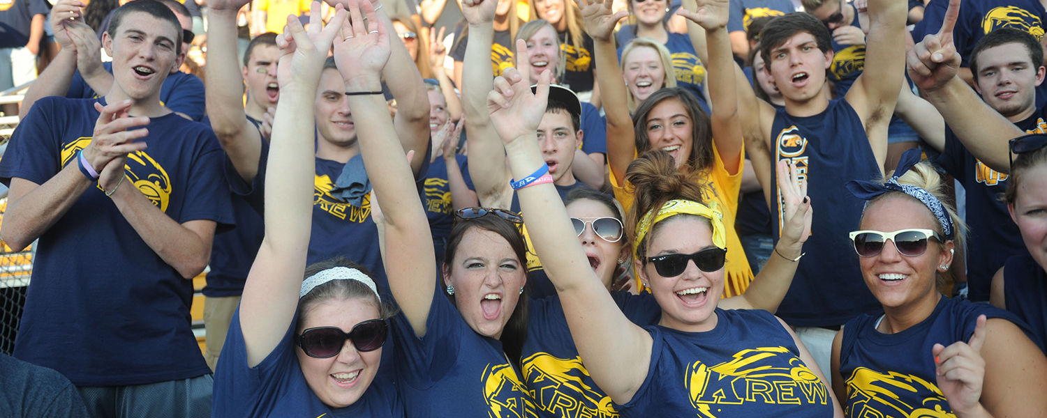 Kent State Golden Flashes fans celebrate a victory at the first home football game against Liberty University.