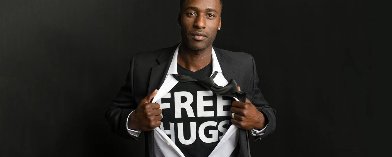"Ken E. Nwadike, Jr is a documentary filmmaker, motivational speaker, and peace activist popularly known as the ""Free Hugs Guy."""
