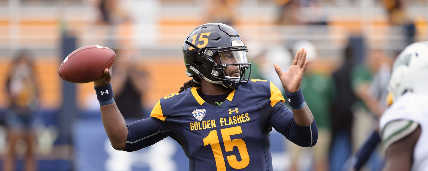 Kent State quarterback Woody Barrett throws an 75-yard touchdown pass on the first play of the game against Ohio University at Dix Stadium.