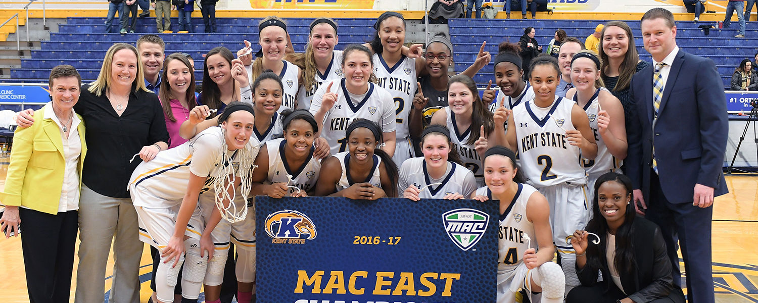 The Kent State women's basketball team poses for photos with President Beverly Warren (far left) after closing out the regular season as MAC East Division Champions for the 2016-2017 season.