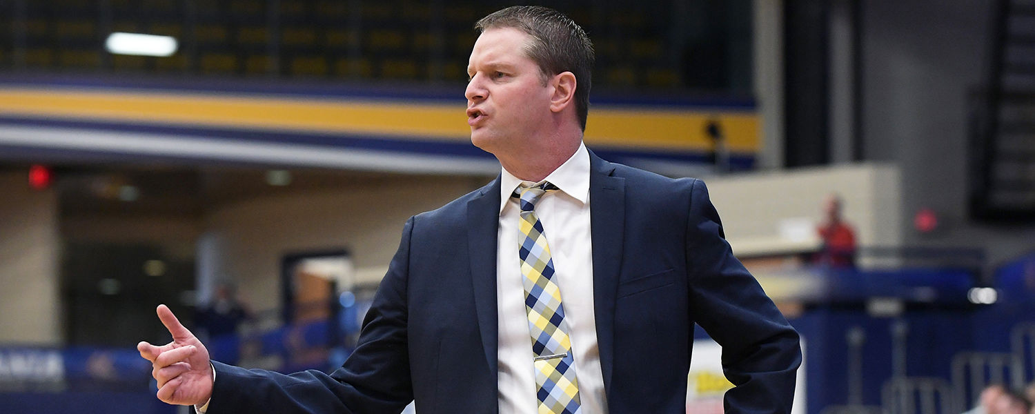 Kent State women's basketball head coach Todd Starkey paces the sidelines of the MAC Center during the season finale against the visiting Buffalo Bulls. Kent State defeated the Bulls 80-71.