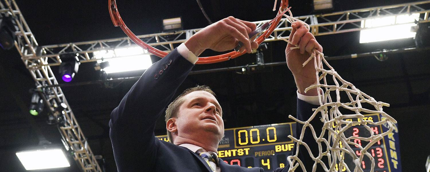 Kent State head coach Todd Starkey finishes cutting down the net in the MAC Center after the women's basketball team finished the season as 2016-2017 MAC East Division Champions.