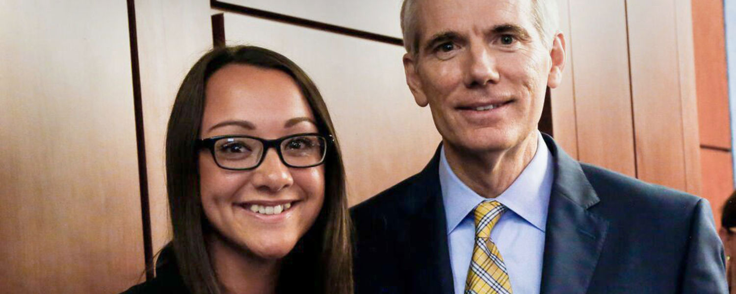 Kent State student Keri Richmond smiles with Sen. Rob Portman from Ohio. Richmond spent part of her summer interning for the U.S. senator. Photo Credit: Kami Swingle