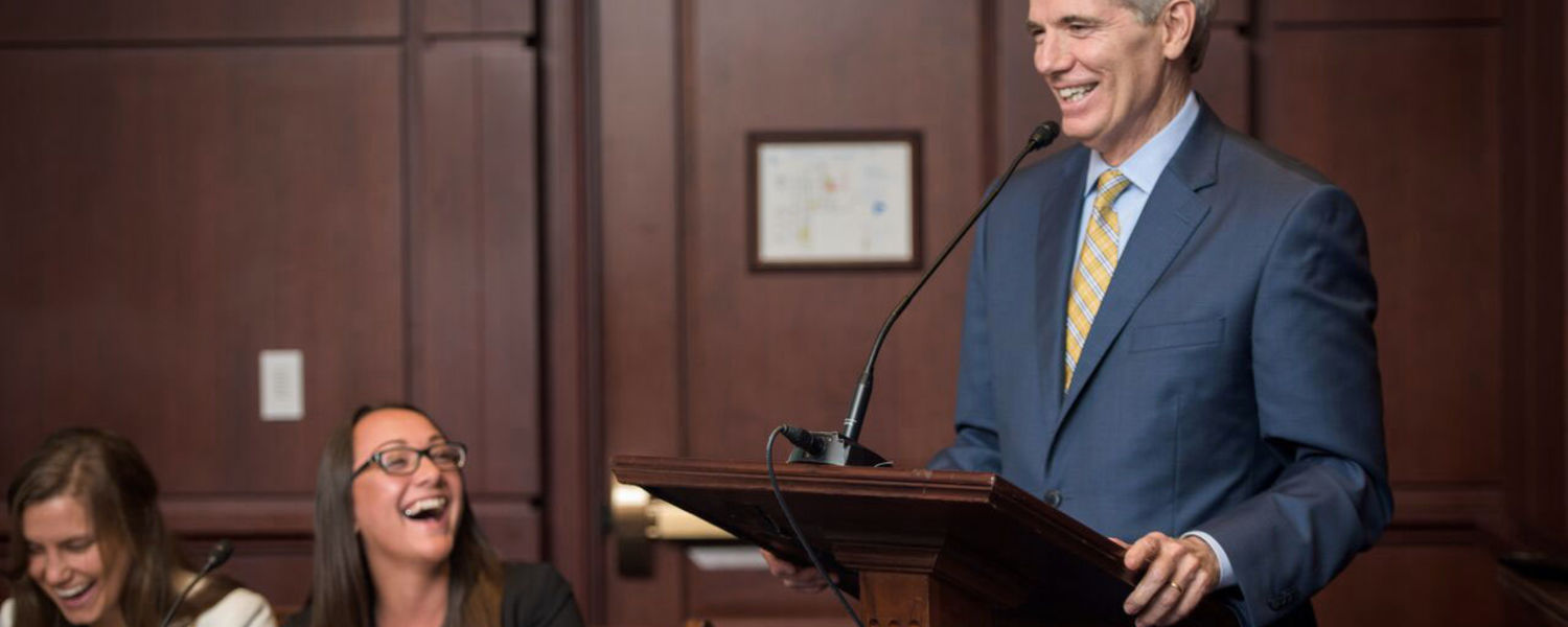 Kent State student Keri Richmond (center) laughs during Sen. Rob Portman's remarks at a Congressional briefing. Photo Credit: Kami Swingle