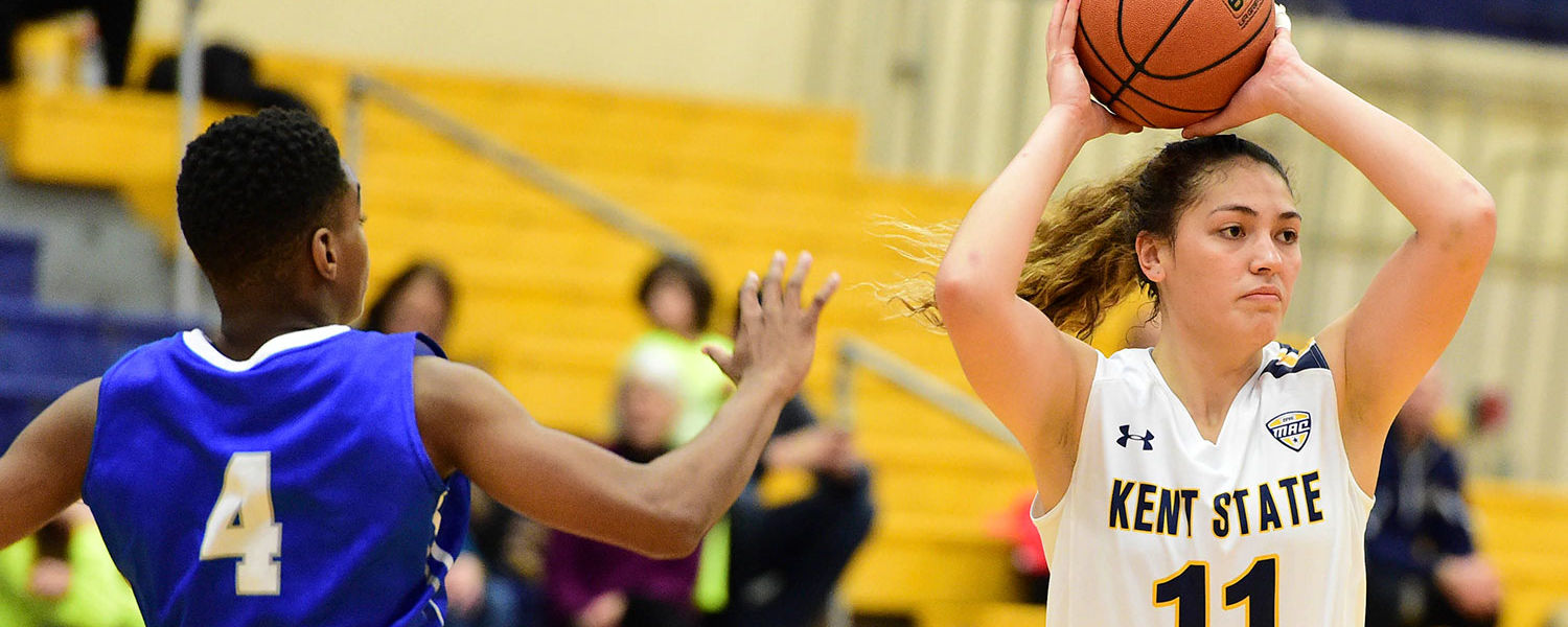 New Zealand native Keziah Lewis, junior accounting major and guard for the Kent State women's basketball team, looks to make a pass during a game.