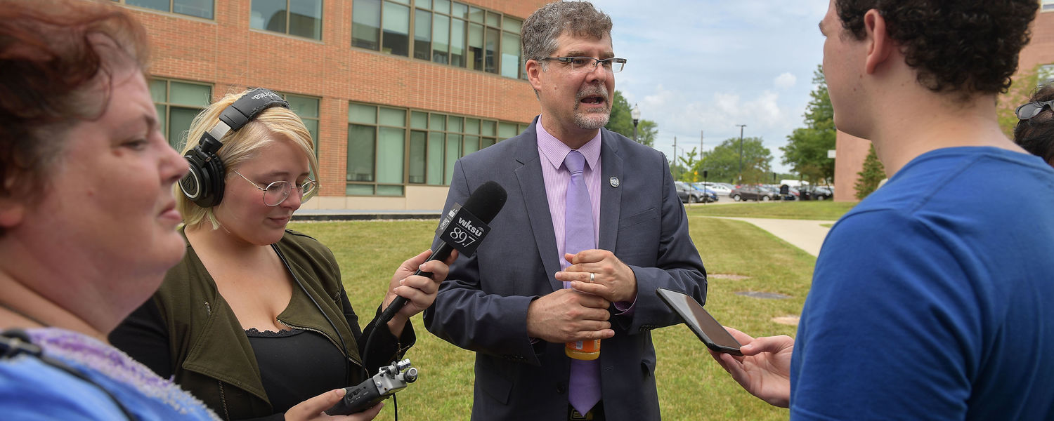 Torsten Hegmann, Ph.D., talks to some reporters after an event announcing him as the director of the Advanced Materials and Liquid Crystal Institute.