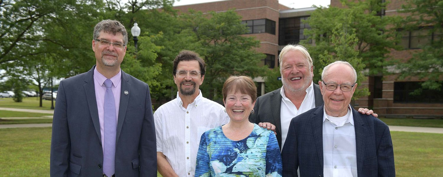Torsten Hegmann, Ph.D., stands with former directors of the Liquid Crystal Institute. Pictured (left to right) are Hegmann; Oleg Lavrentovich, Ph.D.; institute founder Glenn Brown's daughter, Barbara Heffelman; John L. West, Ph.D.; and Bill Doane, Ph.D.