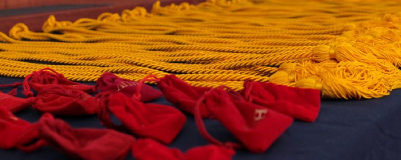 Picture of Lambda Pi Eta honor cords and ribbons