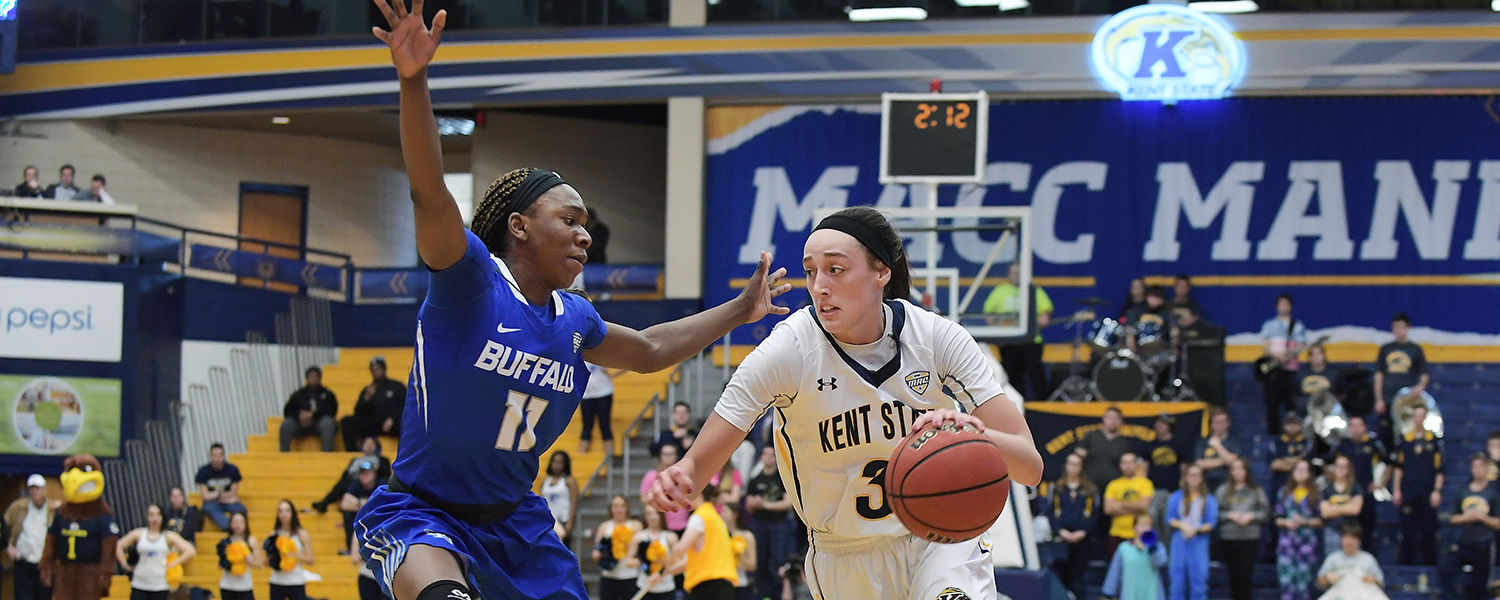 Kent State guard Larissa Lurken drives past a Buffalo defender during the season finale and a Kent State 80-71 win in the MAC Center.