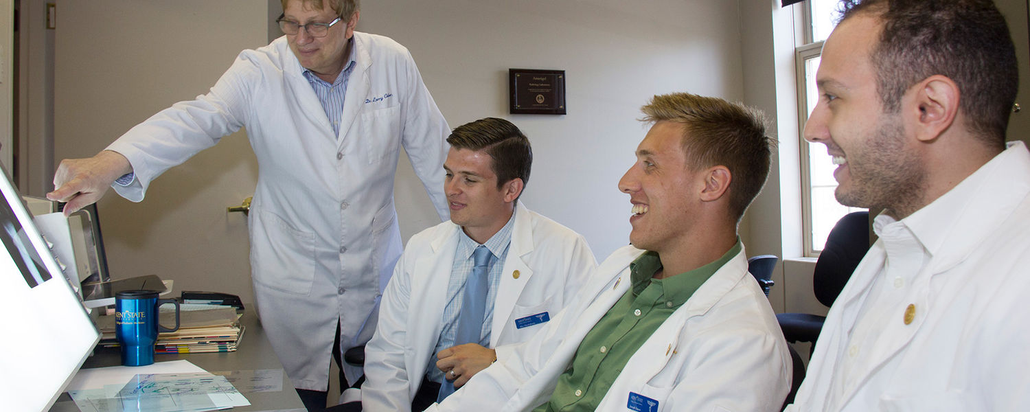 Dr. Lawrence Osher (far left), professor of podiatric medicine, reviews X-rays with some first-year students in the Amerigel Radiology Lab on the Kent State College of Podiatric Medicine campus.