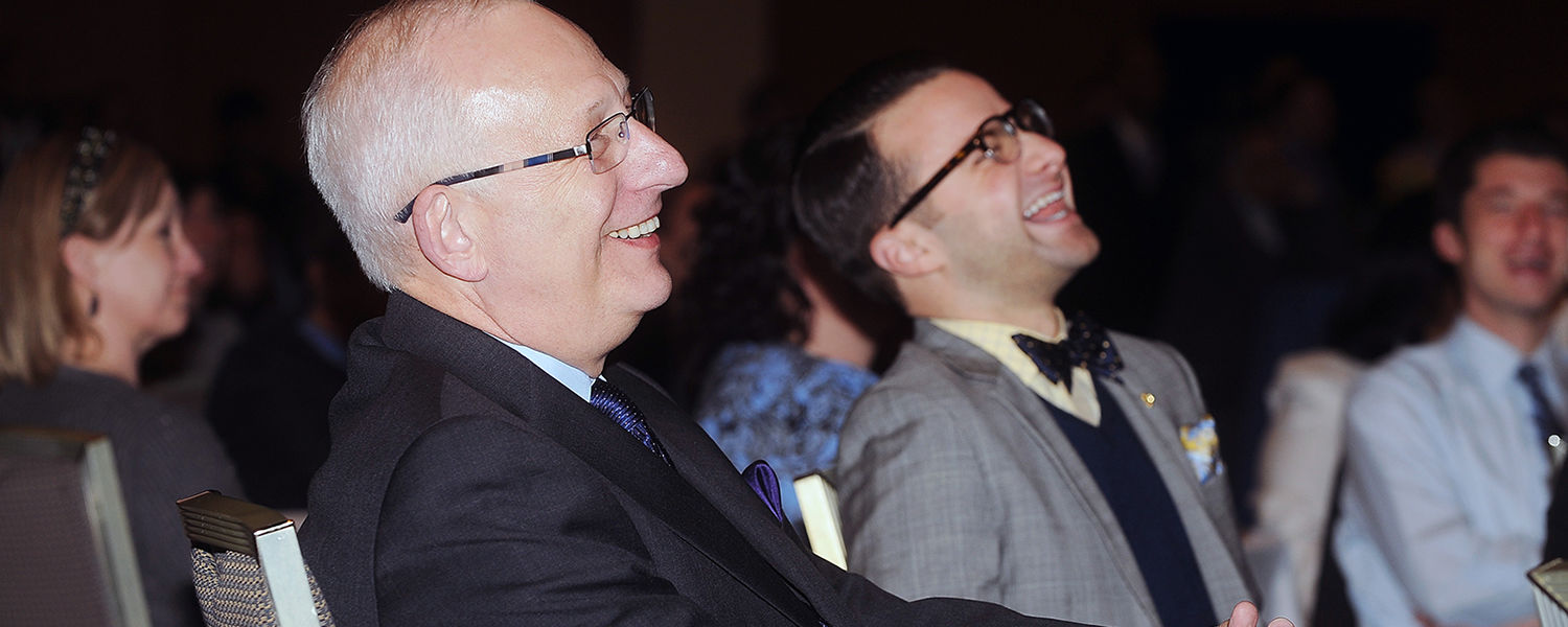 Kent State President Lester A. Lefton shares a laugh with the audience during the playing of a video created in his honor that was shown during the April 4 afternoon reception.