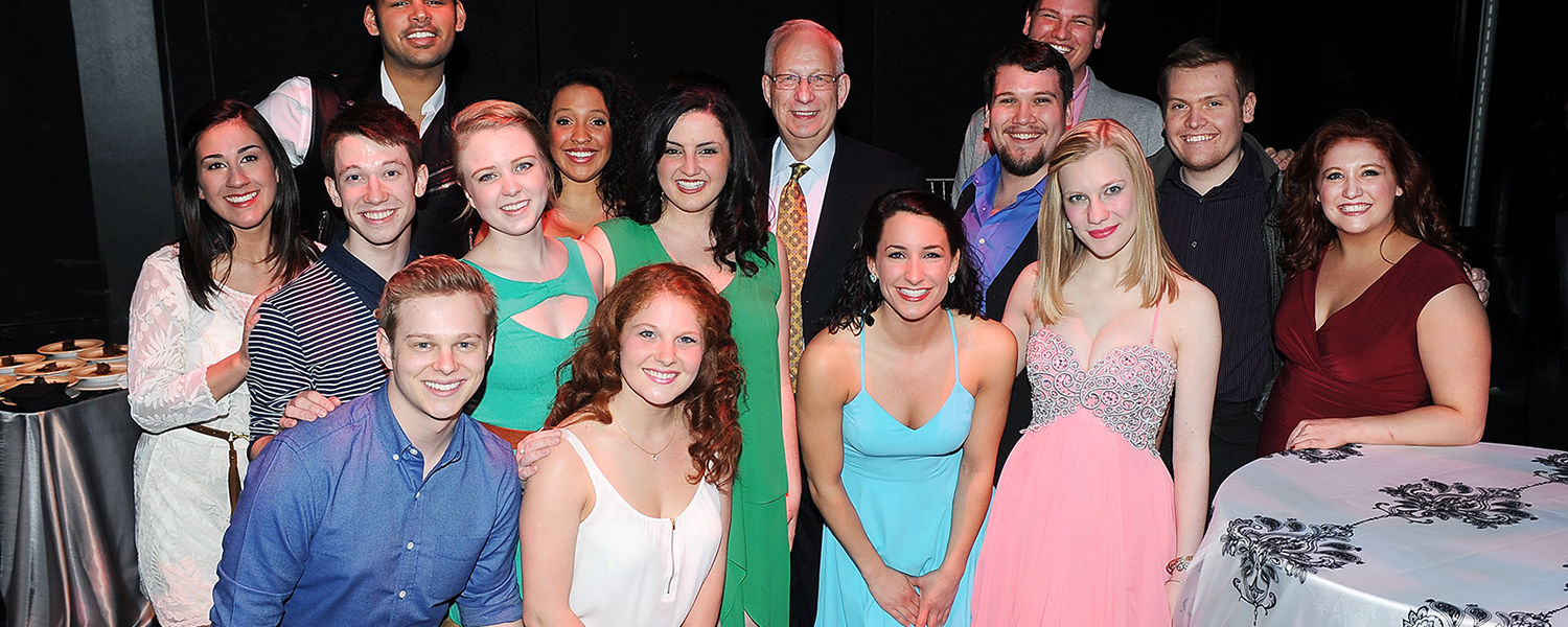 Kent State President Lester A. Lefton poses with students who performed in the Senior Showcase at the April 4 evening reception in the Black Box Theatre.