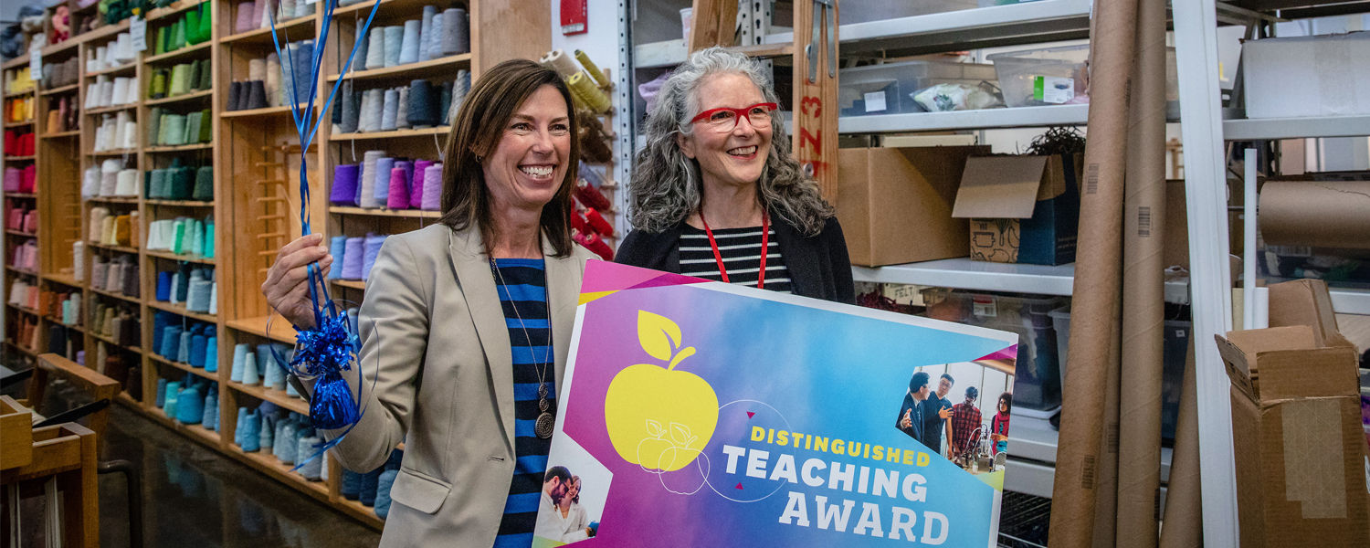 Janice Lessman-Moss Gets a Surprise Visit When She Wins the Distinguished Teaching Award.