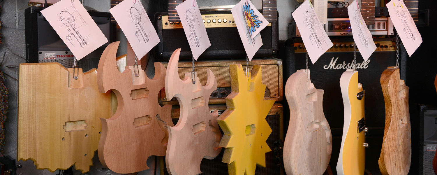 Guitars of different shapes and colors hang to dry at Colby Featherbottom's Custom Sound Machines, a business of Kent State student Ryan Schoeneman.