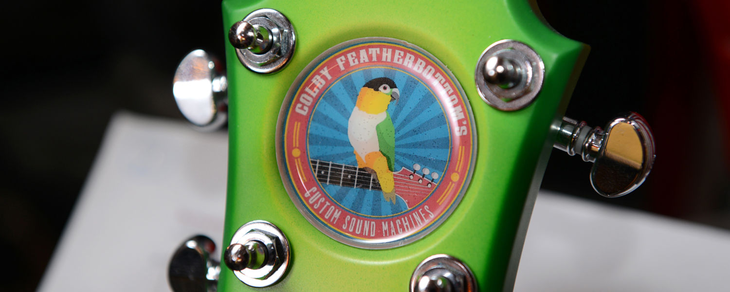 The logo of Colby Featherbottom's Custom Sound Machines features founder and Kent State student Ryan Schoeneman's parrot, which the company is named after.