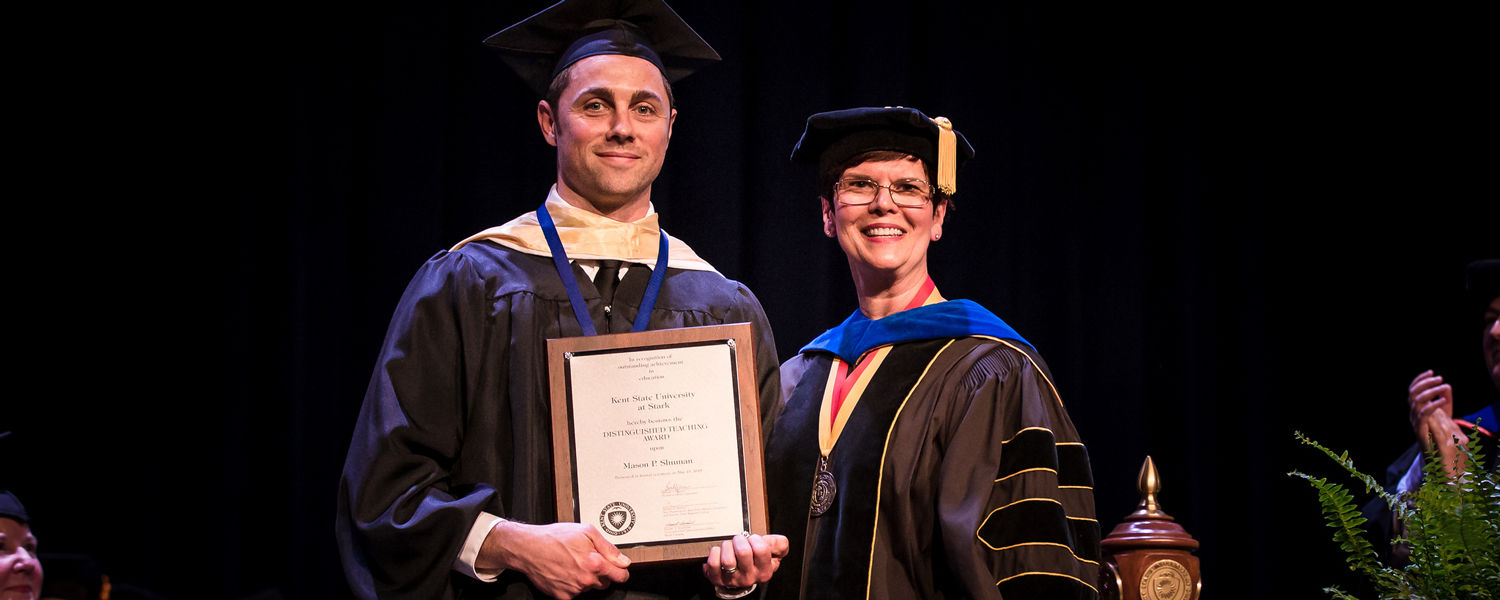 Mason Shuman receives the 2017-18 Distinguished Teaching Award at the Kent State Stark Commencement Ceremony on May 13.