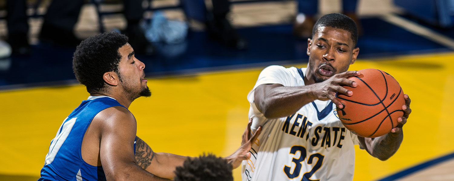 Kent State guard Desmond Ridenour drives through the Ohio Christian defense en route to a commanding 90-45 win in the MACC in the season's home opener.