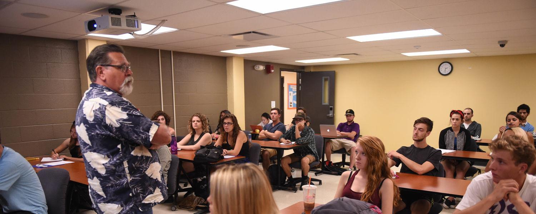 Associate Professor David Trebing, Ph.D., teaches a class in the School of Communication Studies.
