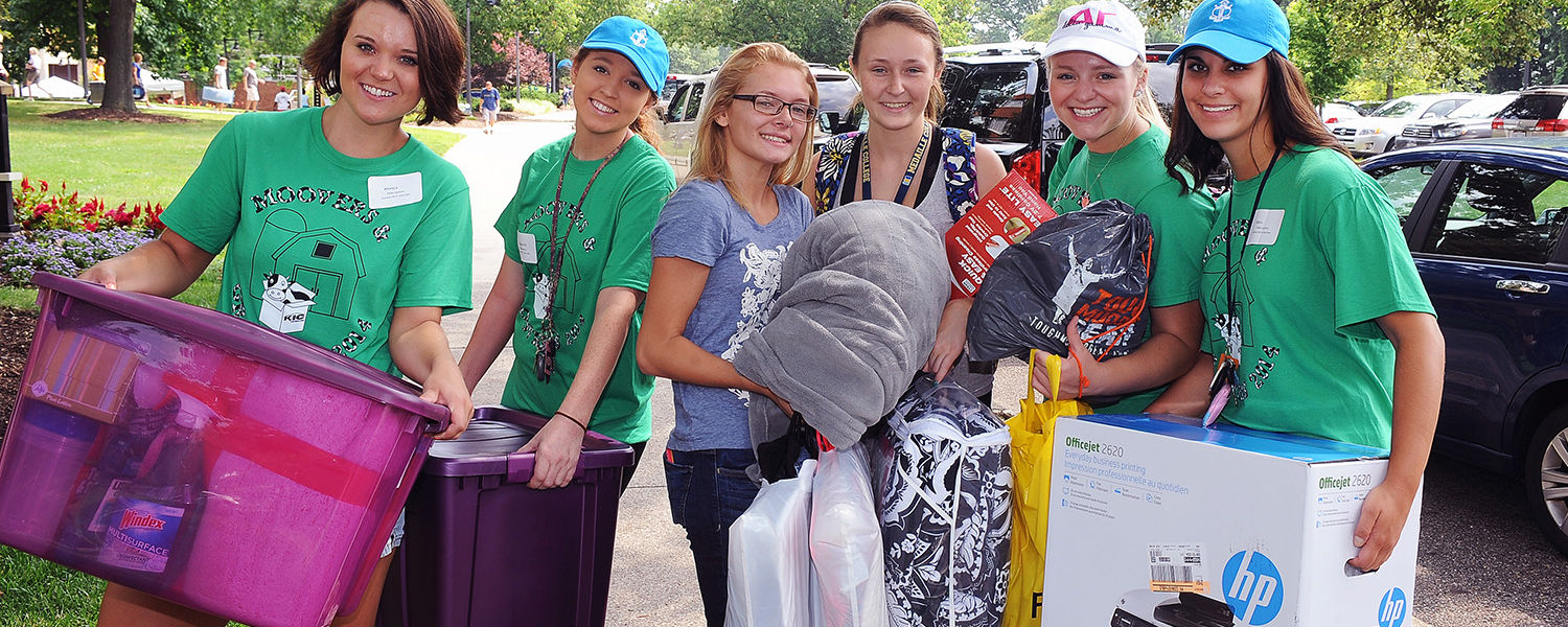 Student volunteers assist two incoming Kent State students who are making the move into the residence halls during freshman move-in day.