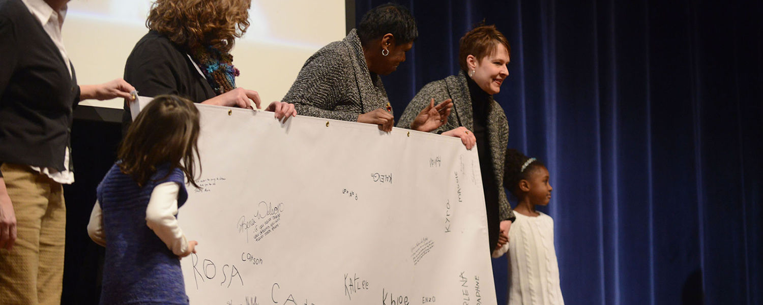Children from Kent State's Child Development Center present a poster during the 2014 Martin Luther King Jr. Celebration