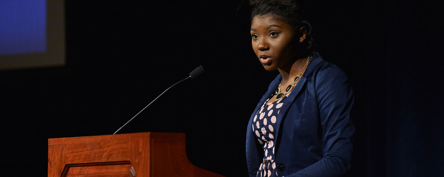 A Kent State student from the School of Journalism and Mass Communication introduces keynote speaker Joy-Ann Reid during the university's 2016 Martin Luther King Jr. Celebration.