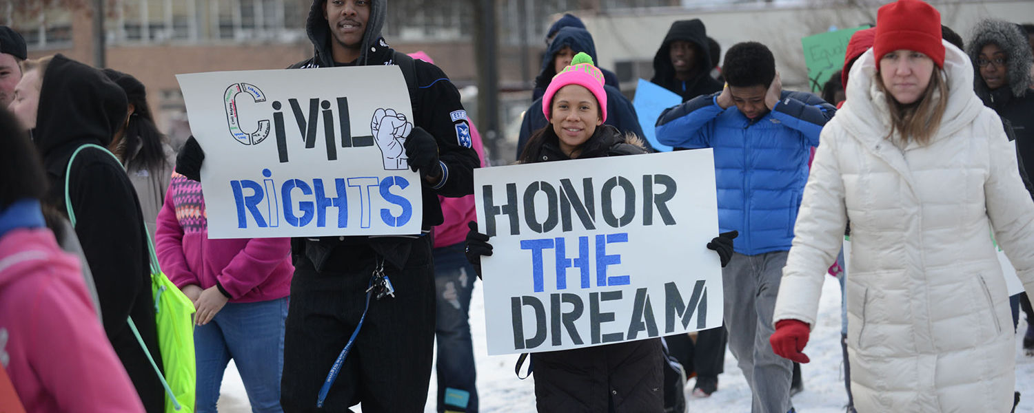 Kent State students march toward Ritchie Hall for a ceremony to honor Martin Luther King Jr.