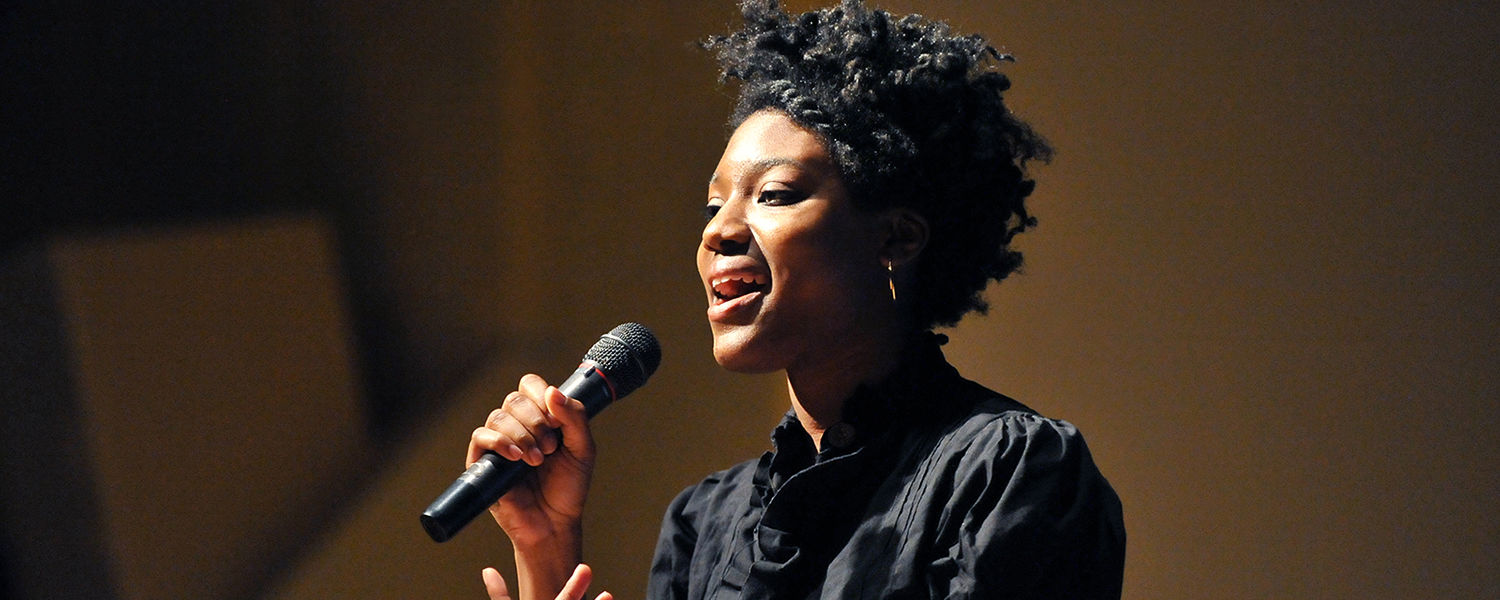 A Kent State student sings in honor of Martin Luther King Jr. in the Kent Student Center Kiva during the university's annual celebration.