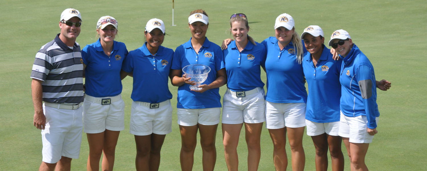 Standing with her team, Kent State's Maddi Swaney (right) has been named Assistant Coach of the Year by the Women's Golf Coaches Association.