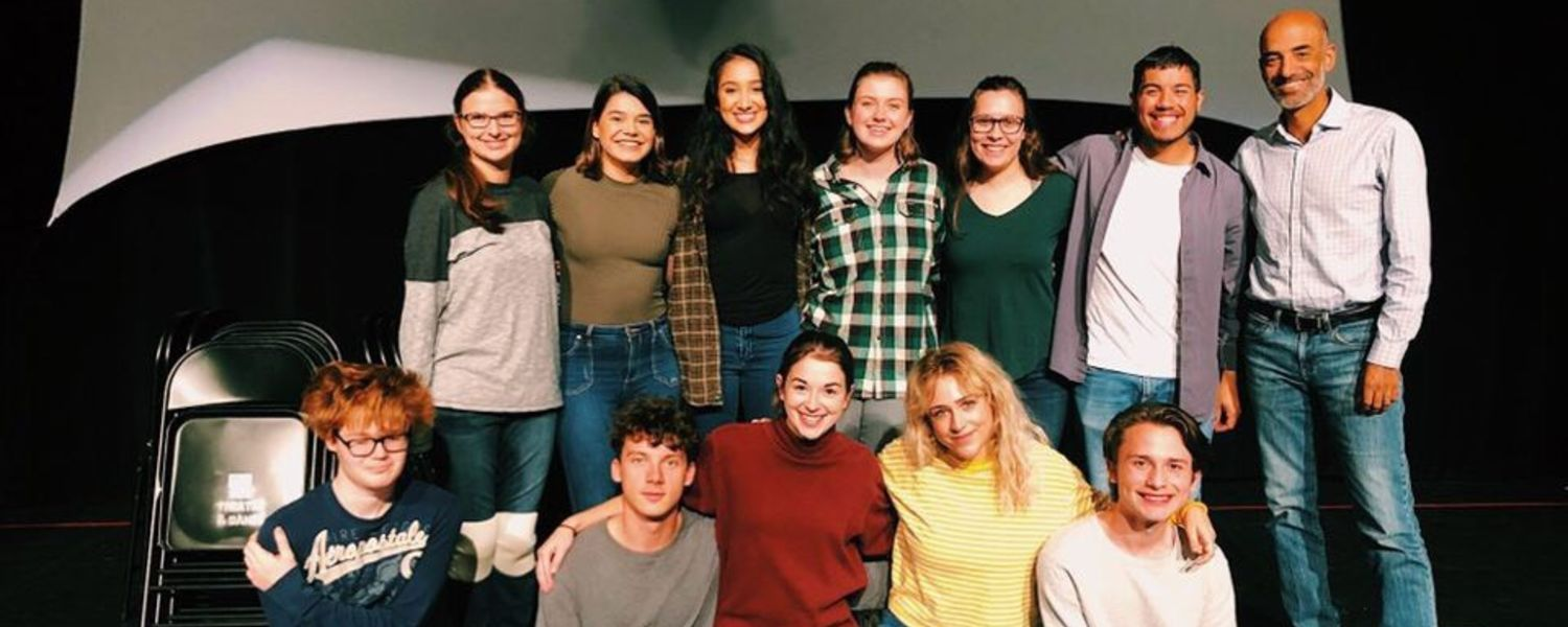 "The cast and crew of ""Manual for a Desperate Crossing"" smile for a group photo."
