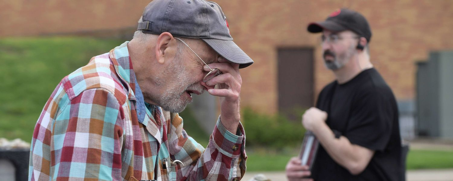 Robert Segall, a family friend of Kent State shooting victim Sandra Scheuer, breaks down in tears after returning to the Prentice Hall parking lot on the campus of Kent State for the first time since May 4, 1970, seeing the spot where she is memorialized.