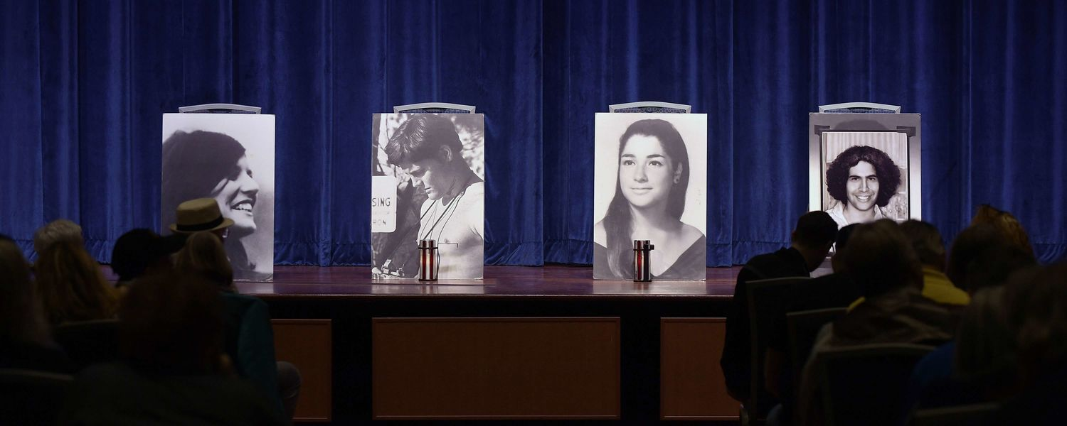 Photographs of the four students killed on May 4, 1970, sit on the stage in the Kent Student Center Ballroom during the annual May 4 Commemoration.