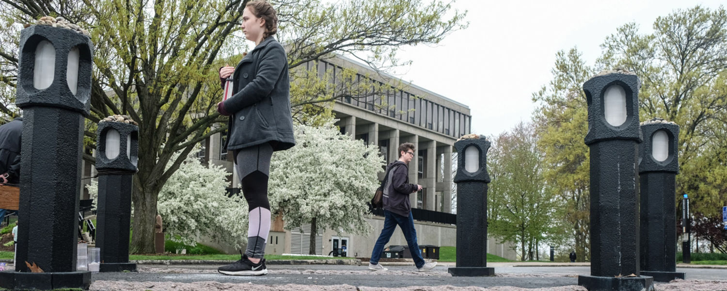 A candle bearer stands vigil on the spot where Allison Krause was shot on May 4, 1970. Ms. Krause was one of the four Kent State students who were killed that tragic day.