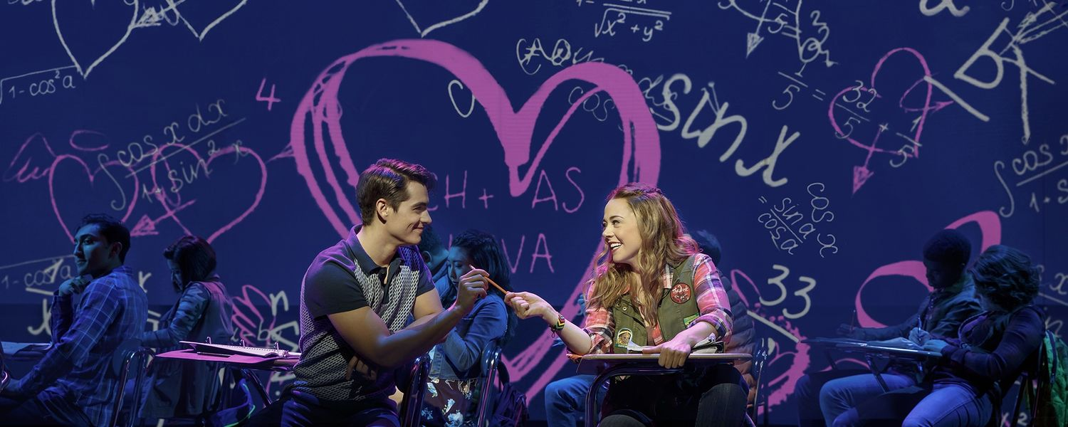 Aaron Samuels (Kyle Selig) and Cady Heron (Erika Henningsen) share a moment in a scene from Mean Girls.