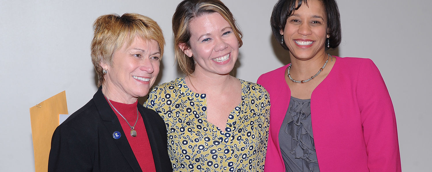 Meghan Cisar (center) poses for photos with Kent State President Beverly Warren (left) and Eboni Pringle (right), interim dean of University College, after receiving a President's Excellence Award.