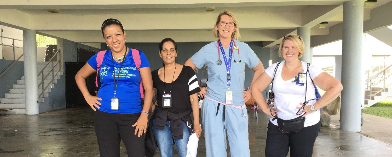 From left: Mia Lind, social worker, Puerto Rico; Gesaline Rivera, social worker, Puerto Rico; Janine Snalley; Katie Blanker, social worker, Wisconsin.