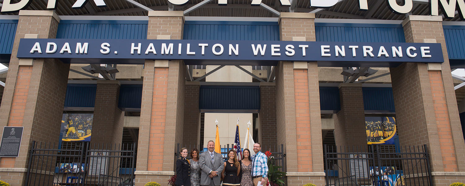 The family of Adam S. Hamilton poses under the west entrance of Dix Stadium which was named in his honor this past fall. Hamilton, a U.S. Army specialist and Kent native, died in Afghanistan during Operation Enduring Freedom.
