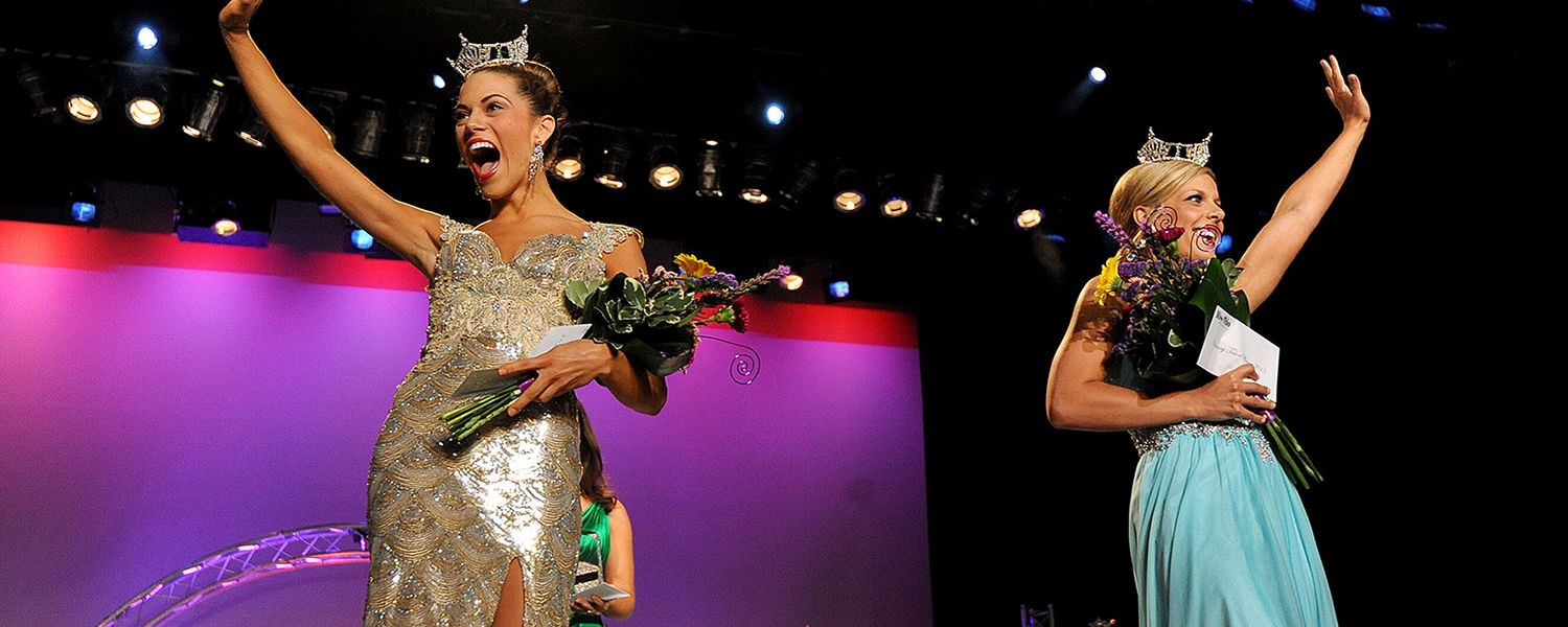 Miss Ohio 2013 Heather Wells (left) waves to the crowd. In addition to being named Miss Ohio, Wells won the preliminary swimsuit competition. She is joined on stage by Miss Miami Valley Cayla Hellwarth, who won the talent portion. (Photo:Jason J. Molyet)