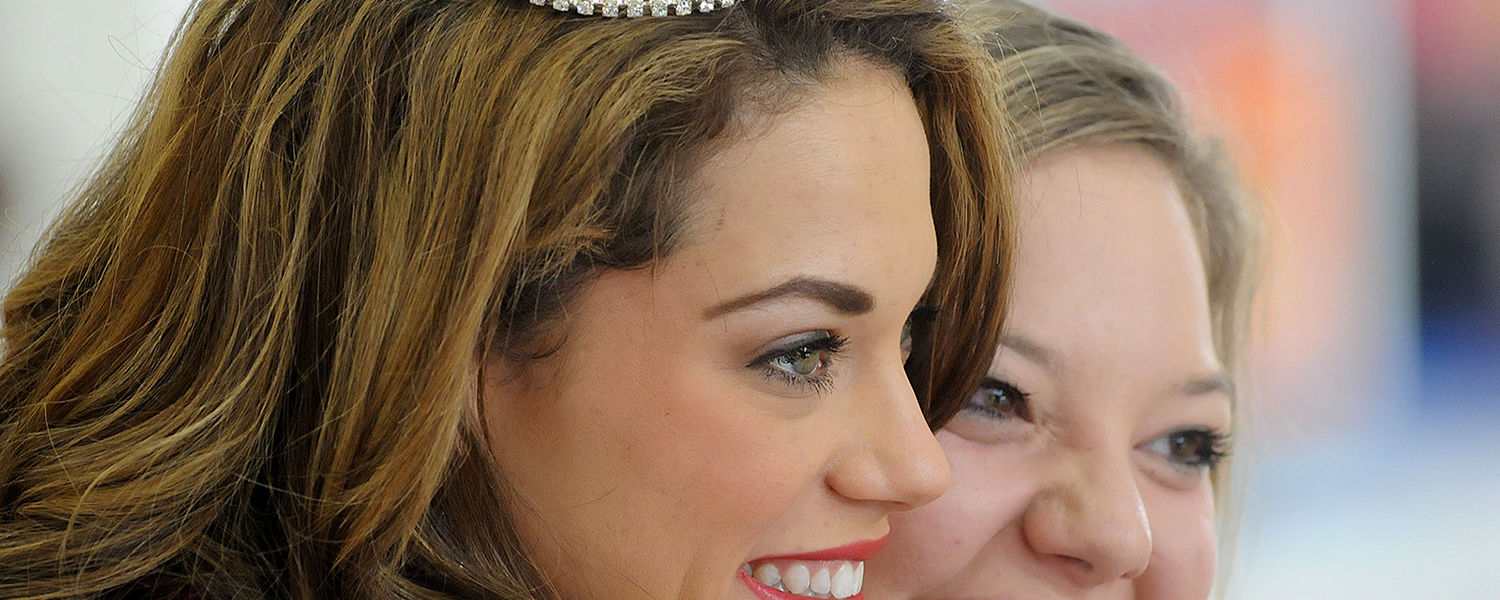 The day after being named Miss Ohio 2013, Heather Wells (left) makes an appearance at the Richland Mall in Mansfield, Ohio, and smiles for a photo with friend and former Miss Ohio contestant Chelsi Howman (right). (Proto credit: Jason J. Molyet/Mansfield