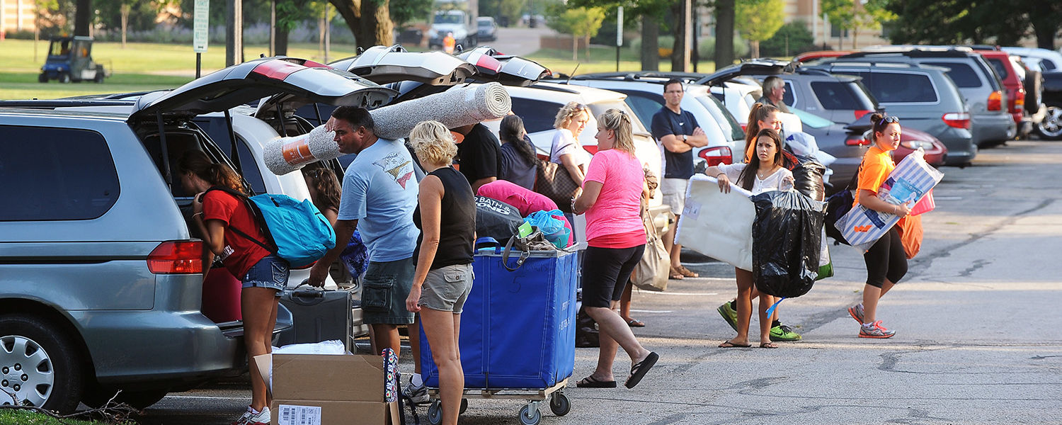 Cars, new Kent State students and parents line the parking lot near Manchester Hall early in the day during the first of two move-in opportunities for incoming freshmen.