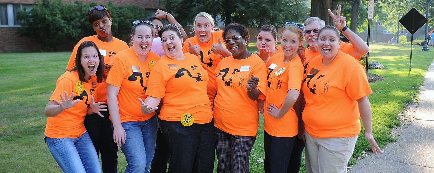 Employees from the Center for Student Involvement display a fun and welcoming spirit on their way to volunteer for Movers and Groovers, helping new students move into the residents halls.