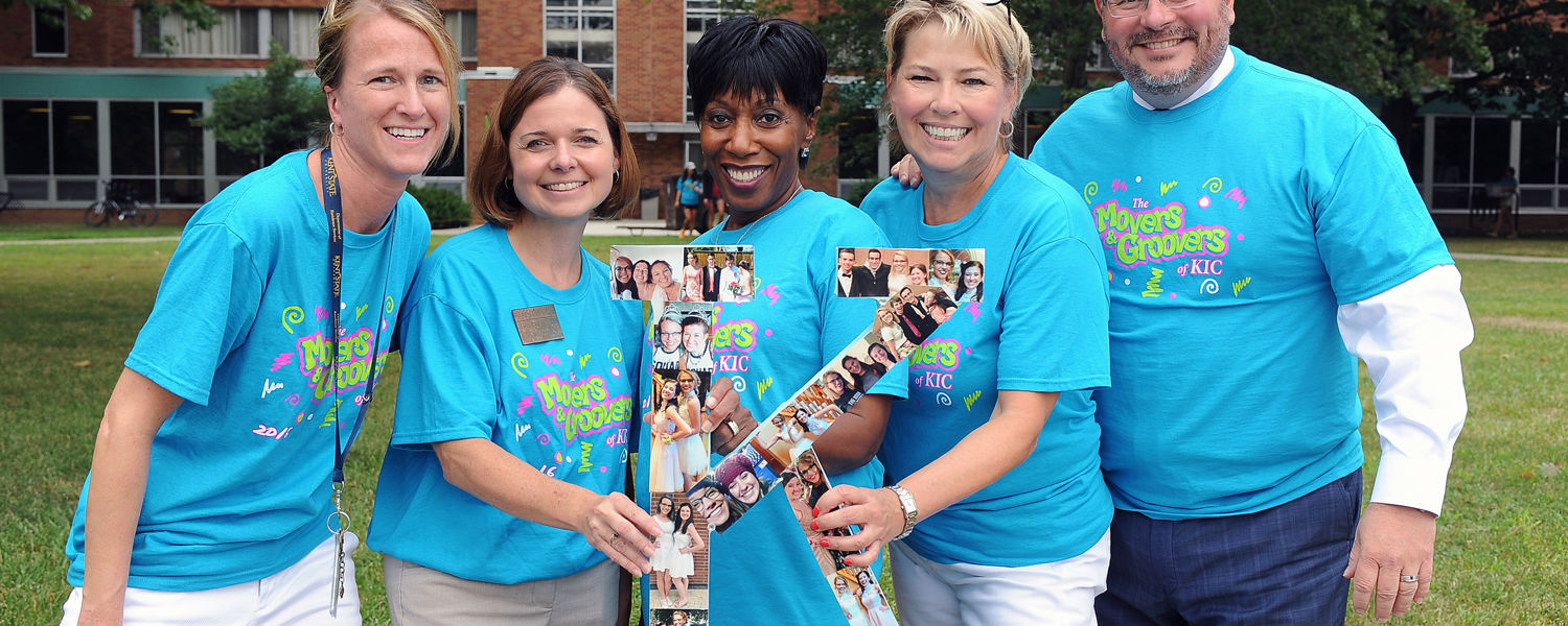"""Kent State's executive officers and university administrators display an incoming freshman's """"K"""" point of pride as they help her move into her residence hall on move-in day."""