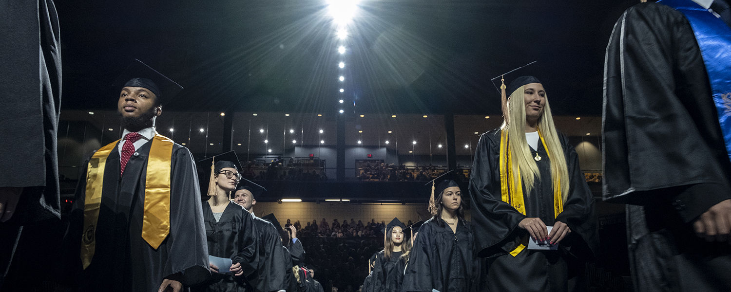 Kent State graduates file into the MAC Center for their  Commencement ceremony.