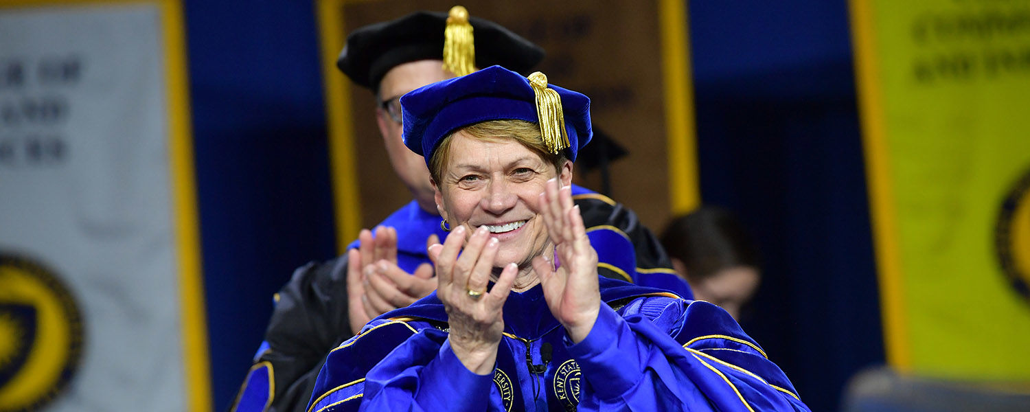 Kent State President Beverly J. Warren applauds the new graduates during a Fall 2018 Commencement ceremony.
