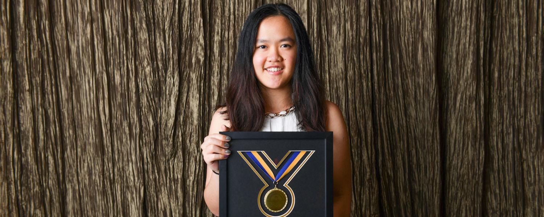 Elena Neoh holding 2019 Golden Flash Award